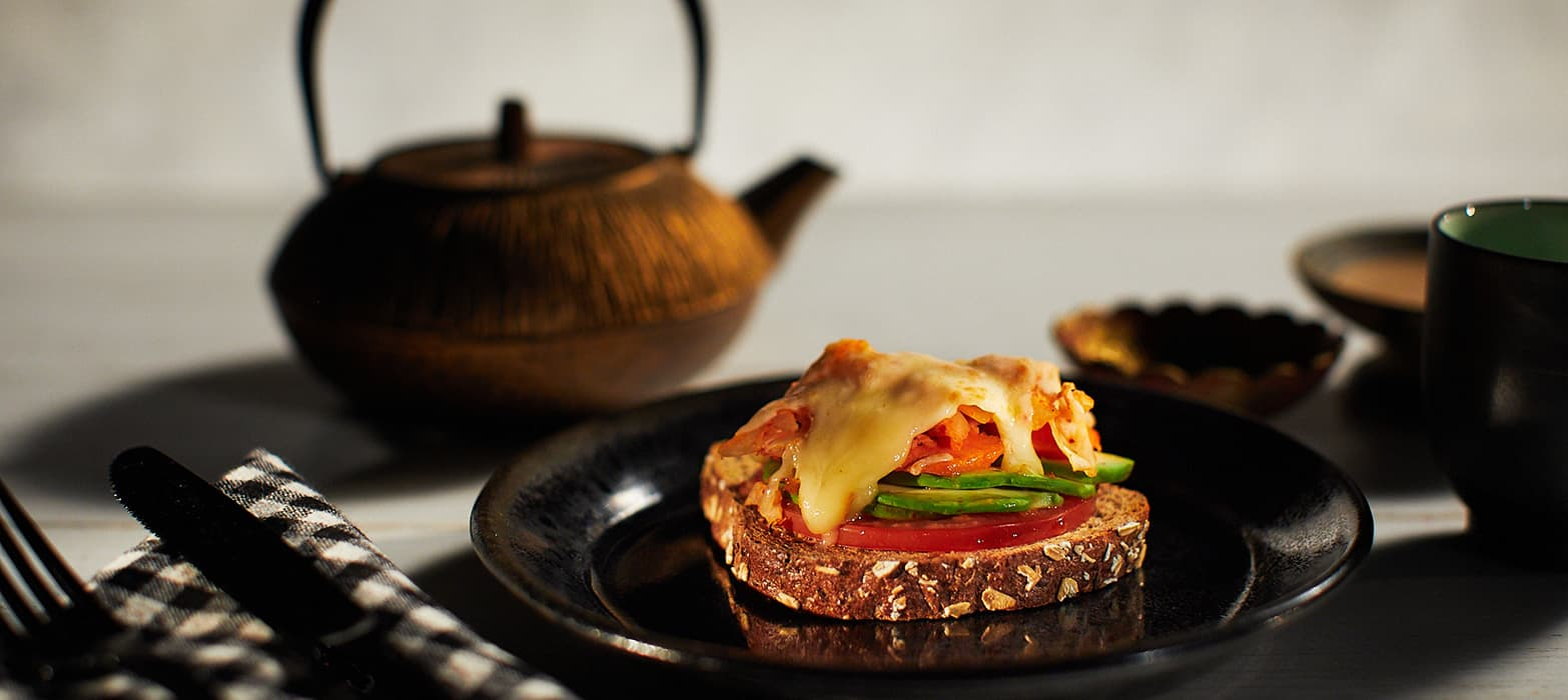 """Stonemill Bakehouse Sprouted 3 Grains """"Kim-cheese"""" Melt with Avocado & Tomato Sandwich"""