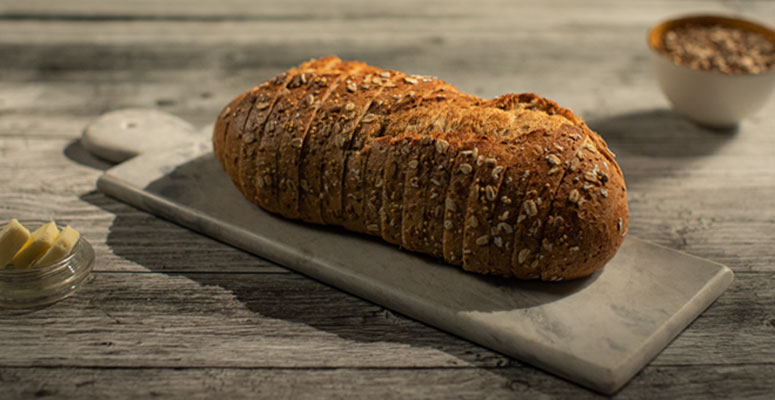 Stonemill Bakehouse naturally fermented bread on cutting board